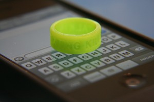 An anti-texting finger band atop an iPhone
